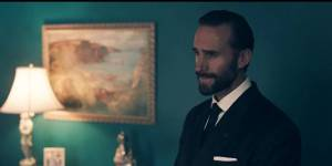 Joseph Fiennes plays Commander Fred Waterford, who owns Offred (Elizabeth Moss) in the series